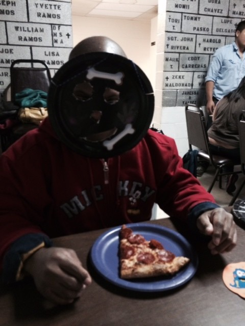 Masks and Pizza Pie at the Halloween Bash